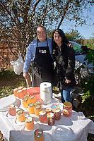market garden in Palermo within urban  community  gardening , honey seller.<br /> Ecomercato all'interno dell'orto urbano condiviso con prodotti biologici,&quot;gli amici delle api&quot; vendono il miele.