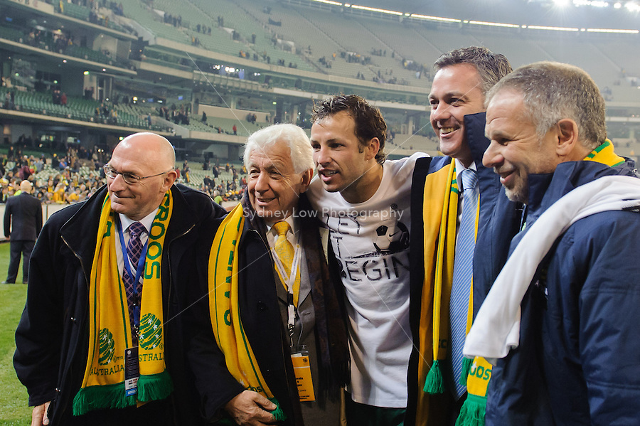 MELBOURNE, 17 JUNE 2009 - The Australian captain Lucas Neill pose for a photograph with Football Australia executives after his team's win in an Asia group 1 qualification match for the FIFA 2010 World Cup between Australia and Japan at the MCG, Melbourne, Australia. 17 June 2009. Photo Sydney Low. This photograph is NOT FOR SALE.