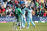 Eoin Morgan (England) congratulates Jofra Archer (England) on the dismissal of Mustafizur Rahman (Bangladesh) during England vs Bangladesh, ICC World Cup Cricket at Sophia Gardens Cardiff on 8th June 2019