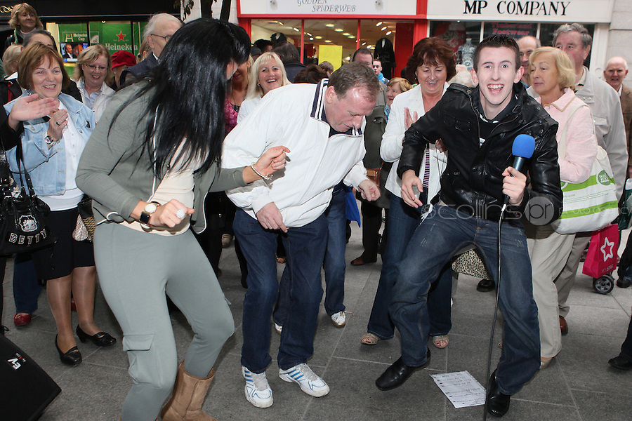 13/10/2010. Crystal Swing Busking. Fans dance with Derek from Cork band Crystal Swing as they launch the busking contest outside the Gaiety Theatre, Dublin for the Mooney radio show on RTE. Picture James Horan/Collins Photos