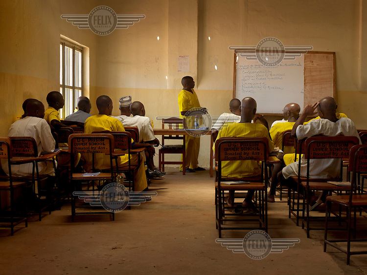 A prisoner's class in business statistics which is taught to university level and is part of the Small Business Management studies at Luzira Upper Prison. Uganda's largest maximum security prison was built in the 1920s to accommodate 600 prisoners. On the 3 April 2015 it housed 3,114, of whom 1,350 were on remand and 1,376 were convicts, plus 388 on Death Row (dressed in white).