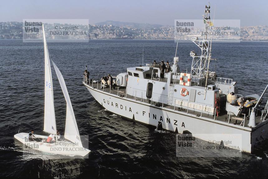 - Financial police, motor patrol vessel controls a sailing boat  in the gulf of Naples ....- Guardia di Finanza, motovedetta controlla una barca a vela  nel  golfo di Napoli