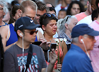 Crowd members become emotional during a large vigil for Heather Heyer Sunday night at 4th Street SE and Water Street in Charlottesville, Va. Heyer was killed and 19 others injured when a car intentionally ran through a crowd of counter protestors after the Unite The Right rally. Photo/Andrew Shurtleff/The Daily Progress