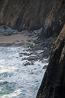 "Friday  29 April 2016<br /> Pictured: Coastguards walk along the cost with a rescue dog dwarfed by the enormous cliffs <br /> <br /> Re: Two fishermen who went missing after a boat sank in Pembrokeshire went overboard while lobster pots were being thrown into the sea.<br /> Gareth Willington, 59, from Carew, died after his boat The Harvester sank off St David's Head on 28 April.<br /> The body of his son, Daniel, 32, has never been found.<br /> Gareth Willington was not wearing a lifejacket when he was found, a report by the Marine Accident Investigation Branch said.<br /> The investigation found the pair were lobster fishing near Ramsay Island when Daniel Willington may have become entangled in ropes on the deck.<br /> His father may have tried to help him before both men went into the water ""in quick succession"", it said."