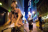 3 July 2005 - New York City, NY, USA - A rider (L) leaves an alleycat checkpoint manned by &quot;Junjun&quot; (2R) on 43rd street in New York City, USA, July 3rd 2005, as another rider (2L) arrives. Alleycats are urban cycle races held informally - without notification of the authorities - on open roads and in real traffic, to simulate the messenger's working conditions. Photo Credit: David Brabyn<br />