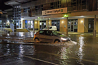Pictured: Flooding in Milford Haven, west Wales, UK.<br /> Re: Emergency services are currently dealing with flooding at the Lower Priory area of Milford Haven, Pembrokeshire.<br /> Dyfed-Powys Police, Mid and West Wales Fire and Rescue Service, Pembrokeshire County Council and Natural Resources Wales are working together to reduce water levels and ensure the public's safety.<br /> The Priory Inn pub and one other property have been affected. There are 12 other houses in the area. Everyone is safe and there is no threat to life at this current time.<br /> The fire and rescue service is using a high volume pump to water from Pill side and discharging into Milford Haven Docks.<br /> Milford Haven Docks are working with emergency services and doing all they can to lower the water levels.<br /> Road closures are in place at Lower Priory Road and the lane between Liddeston and Lower Priory Road. Traffic management is also in place on the Haven Head Bridge.<br /> Members of the public are urged to avoid the area while emergency services carry out their work.