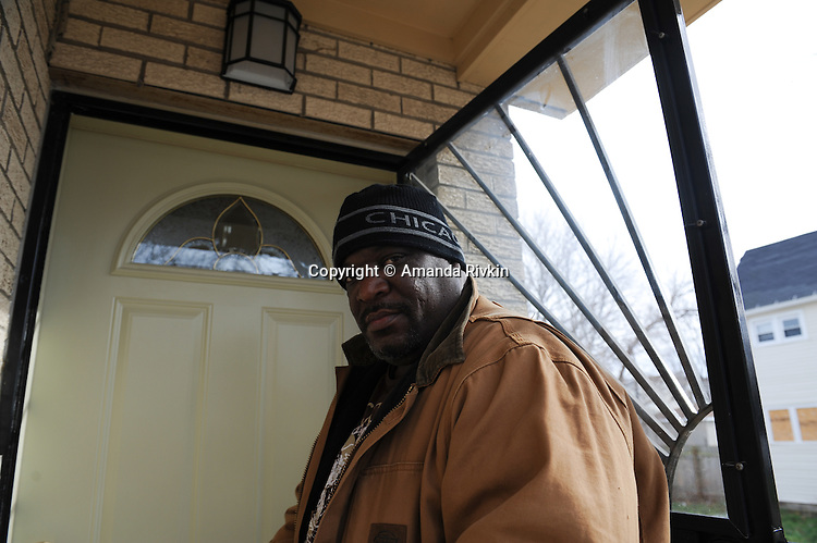 Marvin Reeves, 56, stands on the front steps of the house he bought for his daughter in the Greater Grand Crossing neighborhood in Chicago, Illinois on November 29, 2015.  Reeves purchased and renovated the house with money he received in settlement from the City of Chicago after a codefendant, Ronald Kitchen, and he were both tortured and Kitchen confessed to a crime both were innocent of; Reeves spent 21 years incarcerated from 1988-2009 for a South Side arson that killed two women and three children and had received five consecutive life sentences.