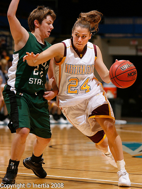 SIOUX FALLS, SD - November 30, 2008 --   Lennea Mueller #24 of Northern State drives past Kim Rosecrans #22 of Bemidji State during their game at the 2008 NSIC Holiday Hoopfest Sunday at the Sioux Falls Arena. (Photo by Dick Carlson/Inertia)