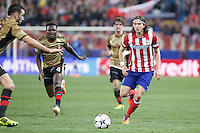 Atletico de Madrid´s Filipe Luis (R) and Milan´s Sulley Muntari during 16th Champions League soccer match at Vicente Calderon stadium in Madrid, Spain. March 11, 2014. (ALTERPHOTOS/Victor Blanco)