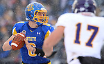 BROOKINGS, SD - NOVEMBER 15: Austin Sumner #6 from South Dakota State University looks for a receiver as Kevin Kintzel #17 from Western Illinois defends in the second quarter Saturday afternoon at Coughlin Alumni Stadium in Brookings. (Photo by Dave Eggen/Inertia)