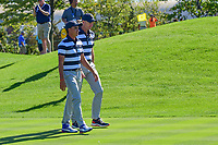 Rickie Fowler (USA) chats with U.S. Team Captain Jim Furyk (USA) on their way down 7 during round 1 foursomes of the 2017 President's Cup, Liberty National Golf Club, Jersey City, New Jersey, USA. 9/28/2017.<br /> Picture: Golffile | Ken Murray<br /> ll photo usage must carry mandatory copyright credit (&copy; Golffile | Ken Murray)