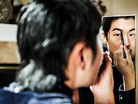 David Yi applies Boy Chanel makeup in Aurora, Colorado, Saturday, September 22, 2018. <br /> <br /> Photo by Matt Nager