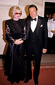 "Mike Wallace, right, correspondent for the CBS-TV show ""60 Minutes"" and his wife, Mary, left, arrive at the White House in Washington, DC for the State Dinner hosted by United States President Ronald Reagan and first lady Nancy Reagan honoring Kenan Evren of Turkey on June 27, 1988.<br /> Credit: Ron Sachs / CNP"