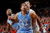 North Carolina forward James Michael McAdoo (43) looks for the rebound in front of Virginia forward Evan Nolte (11) during the game at the John Paul Jones arena in Charlottesville, Va. Virginia defeated North Carolina 61-52.