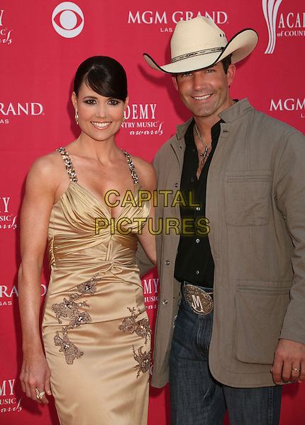 JASON MEADOWS & WIFE.42nd Annual Academy Of Country Music Awards held at the MGM Grand Garden Arena, Las Vegas, Nevada, USA..May 15th, 2007.half length cream hat stetson gold dress brown jacket married husband .CAP/ADM/BP.©Byron Purvis/AdMedia/Capital Pictures