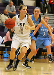 SIOUX FALLS, SD - DECEMBER 5:  Marie Malloy #4 from the University of Sioux Falls gets a step past Sarah Benson #32 from Upper Iowa in the first half of their game Friday night at the Stewart Center.  (Photo by Dave Eggen/inertia)