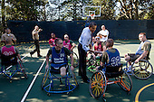 United States President Barack Obama greets players during a Wounded Warrior basketball game on the South Lawn basketball court at the White House, July 26, 2011..Mandatory Credit: Pete Souza - White House via CNP