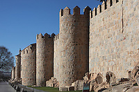 City Walls, 11th-14th century, Avila, Spain. Avila has superbly preserved walls built as fortifications against the Moors, an ancient cathedral, Romanesque churches, and is a pilgrimage destination due to its association with Carmelite nun St Teresa (1515-82), canonized 1622. The Old Town has been designated a UNESCO World Heritage Site. Photograph by Manuel Cohen.