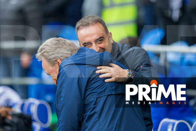 Sheffield Wednesday manager Carlos Carvalhal enjoys a joke with Cardiff City manager Neil Warnock ahead of the Sky Bet Championship match between Cardiff City and Sheffield Wednesday at Cardiff City Stadium, Cardiff, Wales on 16 September 2017. Photo by Mark  Hawkins / PRiME Media Images.