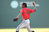 Starting pitcher Luis Martinez (12) of the Kannapolis Intimidators delivers a pitch in a game against the Greenville Drive on Wednesday, July 12, 2017, at Fluor Field at the West End in Greenville, South Carolina. Greenville won, 12-2. (Tom Priddy/Four Seam Images)