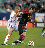 Mexico's Rafael Marquez maneuvers around Costa Rica's Alvaro Saborio.  Mexico defeated Costa Rica 4-1 at the 2011 CONCACAF Gold Cup at Soldier Field in Chicago, IL on June 12, 2011.