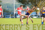 Kenmares Adrian Spillane tries to block down this shot from the boot of Dingles Ryan Begley during their county championship clash in Templenoe on Saturday.