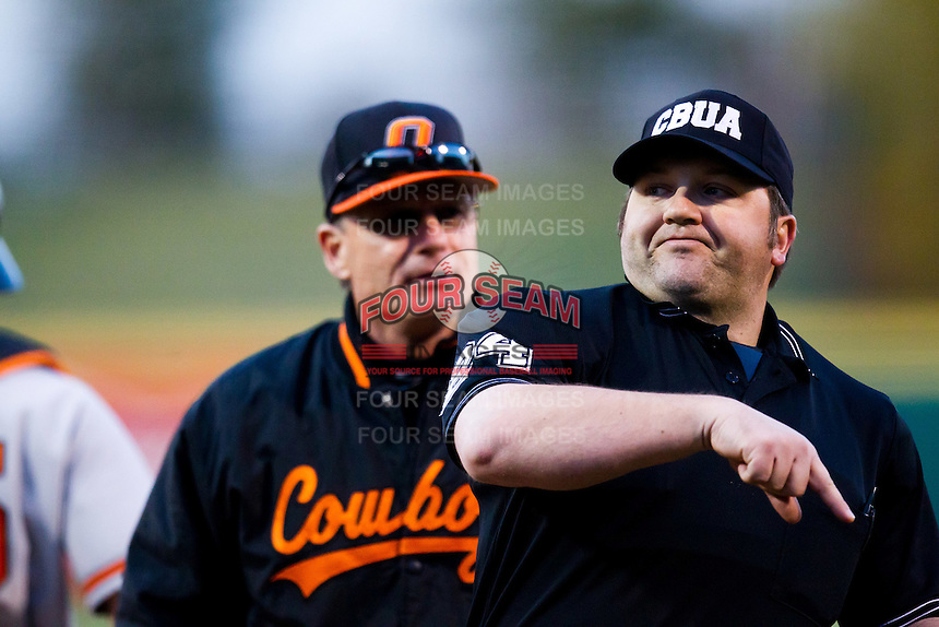 Home Plate Umpire John Brammer (24) throws out Head Coach Frank Anderson (3) of the Oklahoma State Cowboys during a game against the Missouri State Bears at Hammons Field on March 6, 2012 in Springfield, Missouri. (David Welker / Four Seam Images)