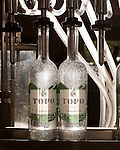 June 18, 2013. Chapel Hill, North Carolina<br />  Bottles of TOPO Gin are filled using a repurposed milking machine.<br />  TOPO, Top of the Hill Distillery, the brainchild of owner Scott Maitland and Spirit Guide Esteban McMahan, is located in the old N&amp;O Building on Franklin Street. Making gin, vodka and American whiskey from locally sourced wheat, they are one of the few distilleries bringing  organic liquor to ABC shelves around the state.