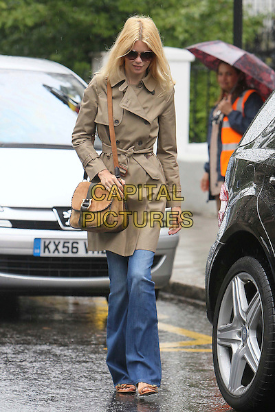 Claudia Schiffer .Spotted on the school run, London, England..June 6th, 2011.full length jeans denim wide leg flared beige mac satchel bag purse sunglasses shades sandals.CAP/HIL.©John Hillcoat/Capital Pictures .