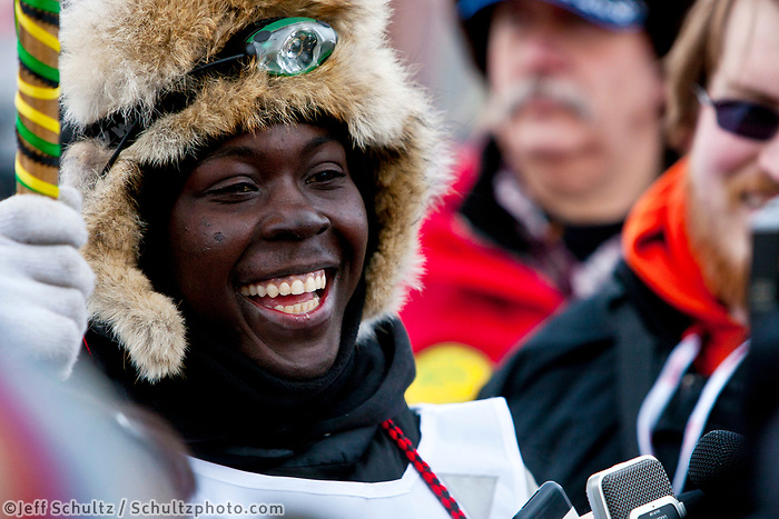 The first ever Jamaican musher, Newton Marshall, at the finish line in Nome during the 2010 Iditarod
