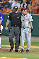 Florida State Seminoles head coach Mike Martin #11 has a talk with home plate umpire Scott Erby during a game against the Clemson Tigers at Doug Kingsmore Stadium on March 22, 2014 in Clemson, South Carolina. The Seminoles defeated the Tigers 4-3. (Tony Farlow/Four Seam Images)