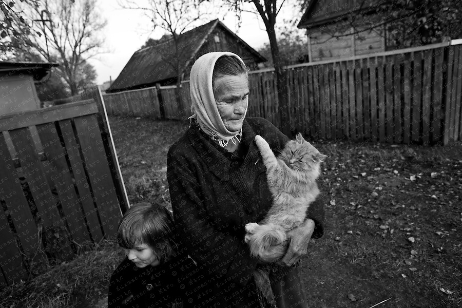 Documenting the echos of Chernobyl Tragedy, An old woman and her granddaughter who never left the exclusion zone, near Prypiat. This area serves as a long term reminder of the mass destruction caused by the nuclear explosion in Chernobyl, Ukraine on April 25-26, 1986.