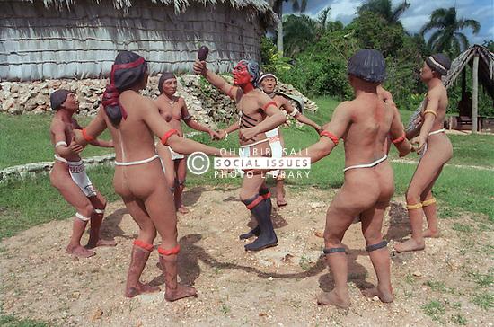 Replica of preColumbian life in Cuba consisting of a lifesized model of a group of Indians dancing in a circle; at 'Chorro de Maita' Taino Indian village near Guardalavaca,