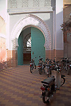 Motorbikes outside door to mosque in the medina, Marrakech, Morocco, north Africa