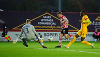 Lincoln City's Shay McCartan, shields the ball from Northampton Town's Hakeem Odoffin, as he rounds Northampton Town's David Cornell, but was unable to convert his chance<br /> <br /> Photographer Chris Vaughan/CameraSport<br /> <br /> Emirates FA Cup First Round - Lincoln City v Northampton Town - Saturday 10th November 2018 - Sincil Bank - Lincoln<br />  <br /> World Copyright © 2018 CameraSport. All rights reserved. 43 Linden Ave. Countesthorpe. Leicester. England. LE8 5PG - Tel: +44 (0) 116 277 4147 - admin@camerasport.com - www.camerasport.com