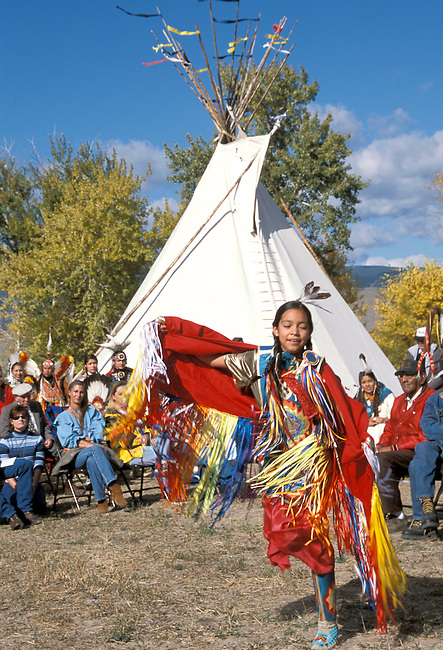10 year old Lemhi-Shoshone girl, Abrahamson, demonstrates being a butterfly through traditional dance steps during a fancy shawl dance at a ground breaking ceremony in Salmon Idaho