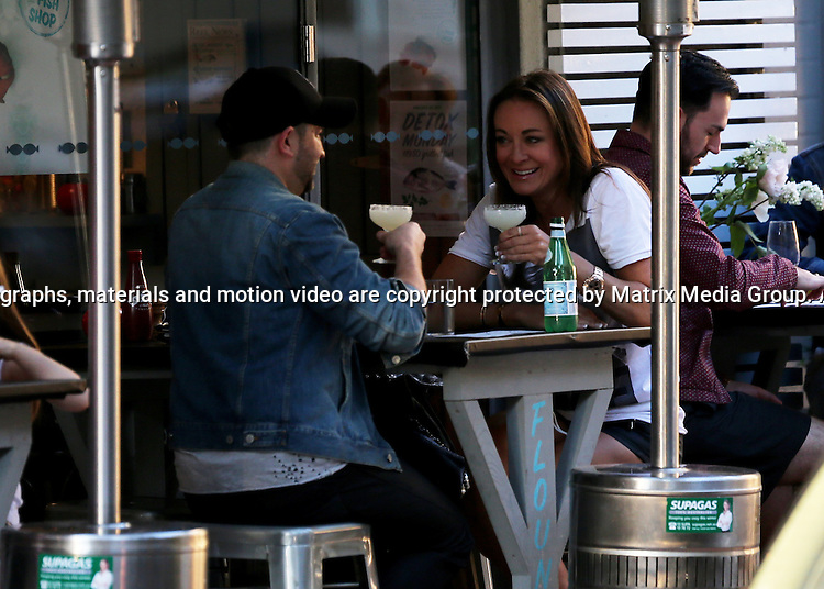 14 SEPTEMBER 2013 SYDNEY AUSTRALIA<br /> <br /> EXCLUSIVE PICTURES<br /> <br /> Michelle Bridges pictured with a friend at The Fish Shop Potts Point enjoying a few drinks and some food. Michelle was looking trim and taunt in shorts which showed off her tanned legs.<br /> <br /> *No internet without clearance*.MUST CALL PRIOR TO USE +61 2 9211-1088. Matrix Media Group.Note: All editorial images subject to the following: For editorial use only. Additional clearance required for commercial, wireless, internet or promotional use.Images may not be altered or modified. Matrix Media Group makes no representations or warranties regarding names, trademarks or logos appearing in the images.