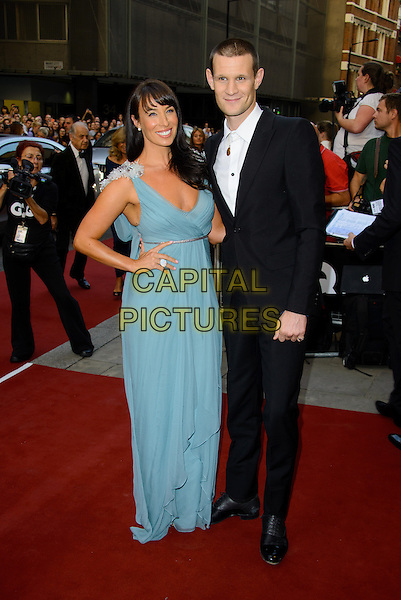 Alexa Chung<br /> GQ Men of the Year Awards 2013 at the Royal Opera House, London, England.<br /> September 3rd, 2013<br /> full length blue dress black suit sister brother siblings family hand on hip<br /> CAP/CJ<br /> &copy;Chris Joseph/Capital Pictures