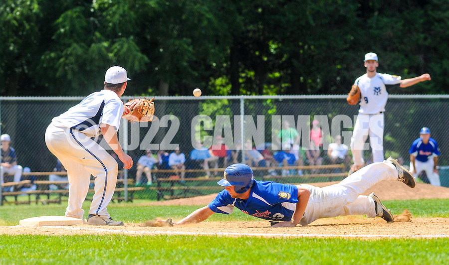Yardley Morrisville first baseman Jack Seibert awaits a throw from pitcher Matt Hesser in an attempt to pick off Roslyn's  Brendan Gallagher as he slides back safely to first base in the 3rd inning at Cairn University Monday July 20, 2015 in Langhorne, Pennsylvania. Roslyn defeated Yardley Morrisville 8-4.  (Photo by William Thomas Cain)
