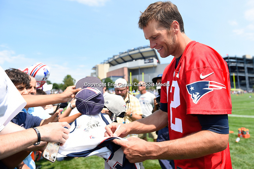 August 1, 2015, Foxborough, MA - New England Patriots quarterback Tom Brady (12) signs autographs after a practice session at the New England Patriots training camp held on the practice field at Gillette Stadium. Eric Canha/CSM