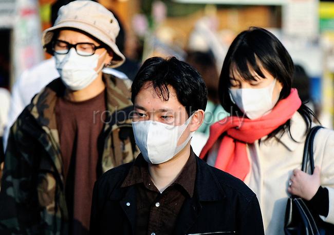 Japanese people wearing surgical masks in Tokyo, Japan