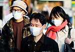 Japanese people wearing surgical masks in Tokyo, Japan