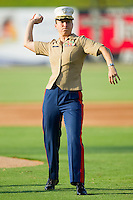 A representative from the United States Marine Corps throws out a ceremonial first pitch prior to the start of the South Atlantic League game between the Augusta GreenJackets and the Kannapolis Intimidators at Fieldcrest Cannon Stadium June 24, 2010, in Kannapolis, North Carolina.  Photo by Brian Westerholt / Four Seam Images