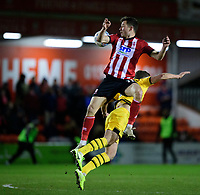 Lincoln City's Tom Hopper vies for possession with Milton Keynes Dons' Jordan Houghton<br /> <br /> Photographer Chris Vaughan/CameraSport<br /> <br /> The EFL Sky Bet League One - Lincoln City v Milton Keynes Dons - Tuesday 11th February 2020 - LNER Stadium - Lincoln<br /> <br /> World Copyright © 2020 CameraSport. All rights reserved. 43 Linden Ave. Countesthorpe. Leicester. England. LE8 5PG - Tel: +44 (0) 116 277 4147 - admin@camerasport.com - www.camerasport.com