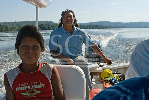 Mato Grosso State, Brazil. Xingu River. Aldeia Metuktire (Kayapo). Benajure Waiwai Txucarramae and his son Rop'ni.