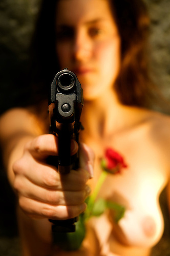 Woman nude holding a gun Naked woman with a gun