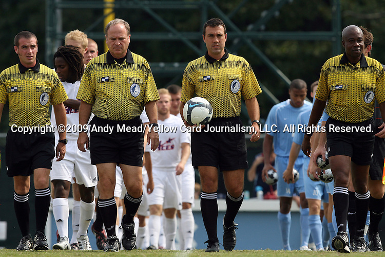 06 September 2009: Match officials march the starting players onto the field. From left: Assistant Referee Justin Bradford, Fourth Official Rich Guarino, Match Referee Tony Crush, Assistant Referee Justus Agbeko. The University of North Carolina Tar Heels defeated the Evansville University Purple Aces 4-0 at Fetzer Field in Chapel Hill, North Carolina in an NCAA Division I Men's college soccer game.