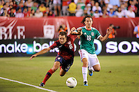 Steve Cherundolo (6)  of the United States and Andres Guardado (18)  of Mexico battle for the ball. The men's national teams of the United States (USA) and Mexico (MEX) played to a 1-1 tie during an international friendly at Lincoln Financial Field in Philadelphia, PA, on August 10, 2011.