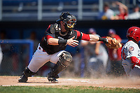 Batavia Muckdogs catcher Alex Jones (55) attempts to tag Juan Soto (26) sliding safely into home during a game against the Auburn Doubledays on September 5, 2016 at Dwyer Stadium in Batavia, New York.  Batavia defeated Auburn 4-3. (Mike Janes/Four Seam Images)