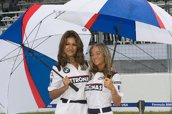MONTREAL - JUNE 22: Two representatives of Sauber BMW pose for photos during the Bridgestone Open House Day on the Thursday prior to race weekend of the  Canadian F1 Grand Prix at the Circuit Gilles-Villeneuve June 22, 2006 in Montreal, Canada.